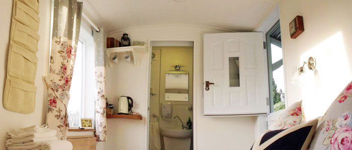Our shepherd's hut is en suite, with a double bed and underfloor heating