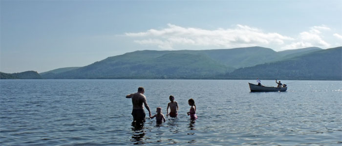 Sunny summer days at Loch Lomond.  Go paddling at the shore, just yards away from the Shepherd's House bed and breakfast.